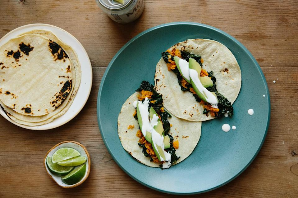 """Kale, avocado, and sweet potato: Some of our very favorite things, in taco form. <a href=""""https://www.bonappetit.com/recipe/green-tacos?mbid=synd_yahoo_rss"""" rel=""""nofollow noopener"""" target=""""_blank"""" data-ylk=""""slk:See recipe."""" class=""""link rapid-noclick-resp"""">See recipe.</a>"""