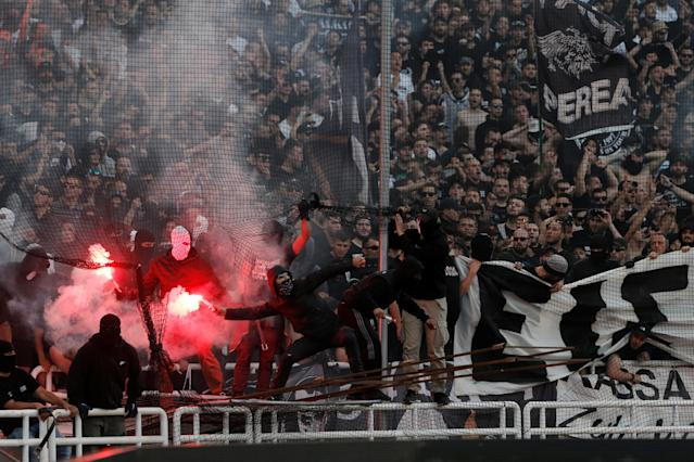 Soccer Football - Greek Cup Final - AEK Athens vs PAOK Salonika - Athens Olympic Stadium, Athens, Greece - May 12, 2018 PAOK Salonika fans with flares before the match REUTERS/Costas Baltas