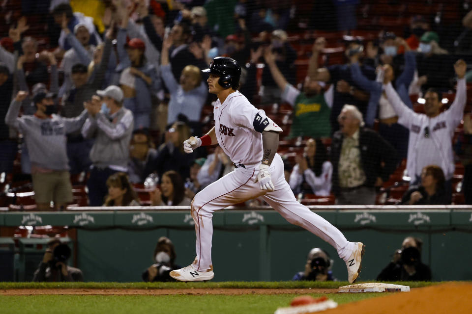 Boston Red Sox's Bobby Dalbec runs the bases after his two-run home run against the Los Angeles Angels during the seventh inning of a baseball game Friday, May 14, 2021, at Fenway Park in Boston. (AP Photo/Winslow Townson)