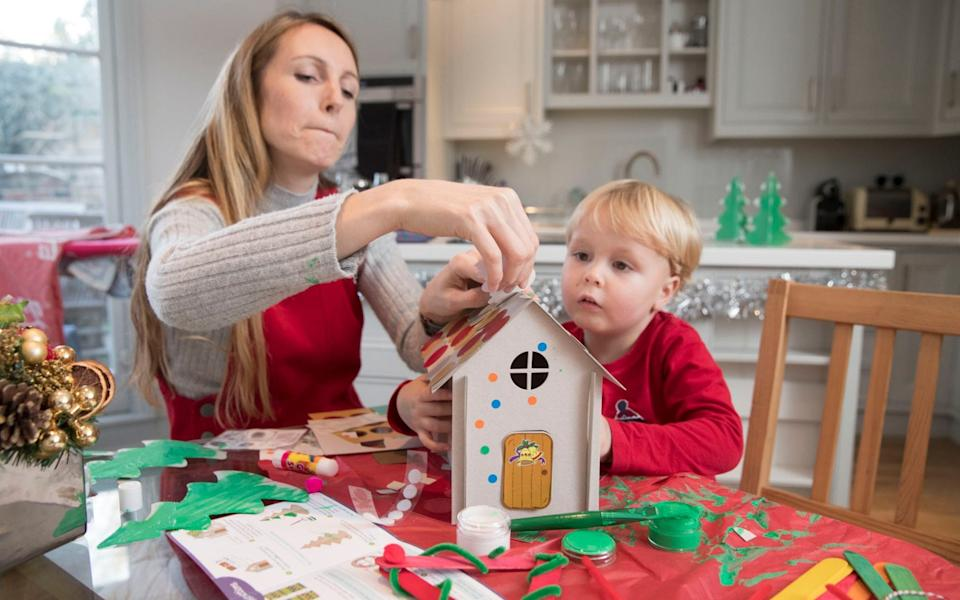 Anna making a cardboard gingerbread house with her son Alfie