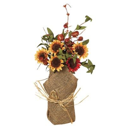 "<div class=""caption-credit""> Photo by: Target</div><div class=""caption-title""></div><b>Burlap Flower Bundle, $14.99</b> <br> Just because the weather's cooling off, doesn't mean you can't use flowers in your home decor! Use these burlap wrapped sunflowers as an awesomely autumnal centerpiece or window decoration. <br> <i>Get it at <a rel=""nofollow"" href=""http://www.target.com/p/autumn-flower-bundle-with-burlap-base-red-orange-16/-/A-14556159#prodSlot=medium_1_27&term=autumn"" target=""_blank"">Target</a></i> <br> <br> <b><i><a rel=""nofollow"" href=""http://www.babble.com/home/15-genius-storage-solutions-for-the-home/?cmp=ELP