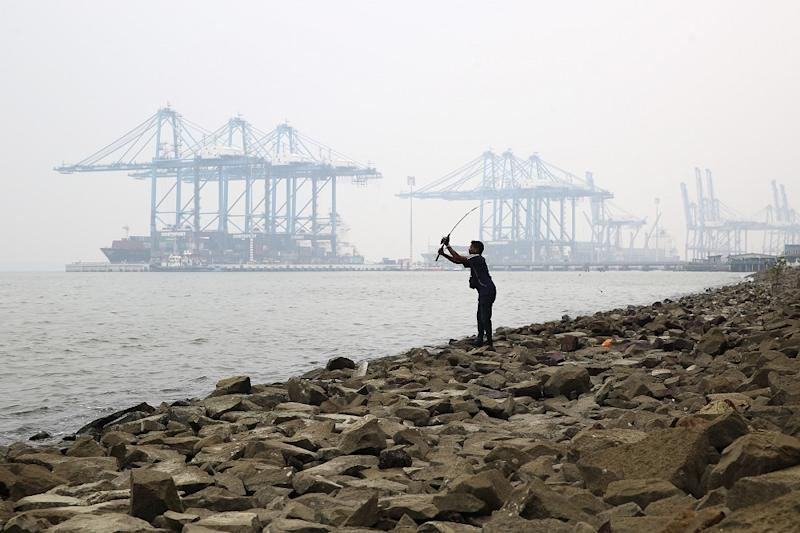 A man is seen fishing on a hazy day in Northport Klang September 9, 2019. — Picture by Yusof Mat Isa