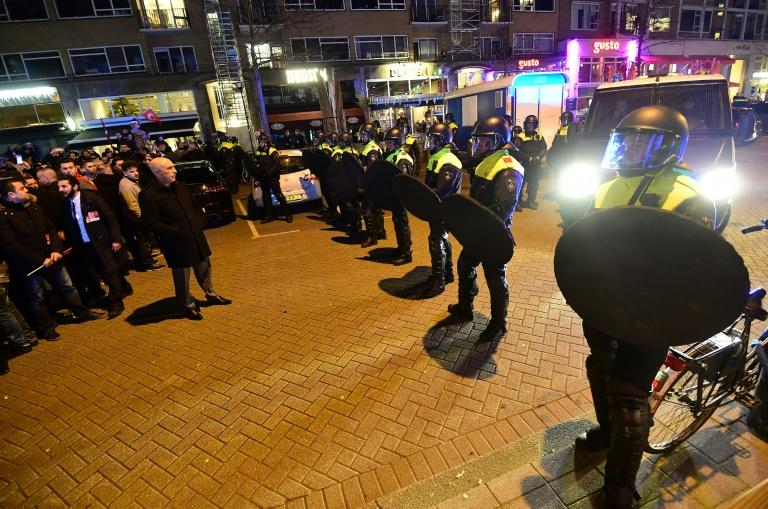 Police forcefully dispersed protesters after several hours of a demonstration by more than 1,000 people outside the Turkish consulate in Rotterdam on March 11, 2017