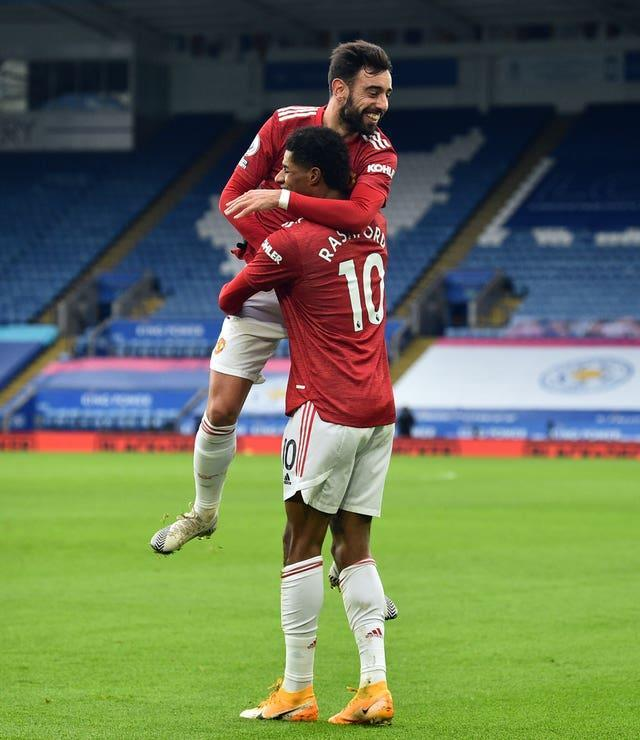 Bruno Fernandes, top, and Marcus Rashford celebrate the latter's goal at Leicester