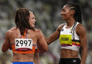 Nafissatou Thiam, of Belgium, right, celebrates with Anouk Vetter, of Netherlands, silver, and Emma Oosterwegel, of Netherlands, left, bronze, after winning the gold medal in the heptathlon at the 2020 Summer Olympics, Thursday, Aug. 5, 2021, in Tokyo, Japan. (AP Photo/Francisco Seco)