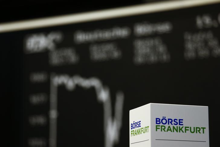 FILE PHOTO: A box with text 'Frankfurt stock exchange' is pictured in front of the German share price index DAX board at the Frankfurt stock exchange