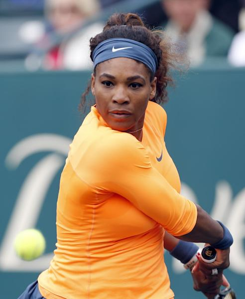 Serena Williams returns to Mallory Burdette during the Family Circle Cup tennis tournament in Charleston, S.C., Friday, April 5, 2013. Williams and Burdette played their third round match on Friday since rain postponed their match on Thursday. (AP Photo/Mic Smith)