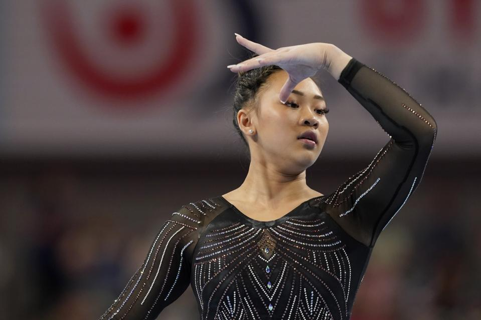 Sunisa Lee warms up in the floor exercise before the U.S. Gymnastics Championships, Sunday, June 6, 2021, in Fort Worth, Texas. (AP Photo/Tony Gutierrez)