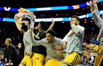 <p>The UMBC Retrievers bench celebrates a growing second half lead against the Virginia Cavaliers during the first round of the 2018 NCAA Men's Basketball Tournament at Spectrum Center on March 16, 2018 in Charlotte, North Carolina. (Photo by Jared C. Tilton/Getty Images) </p>