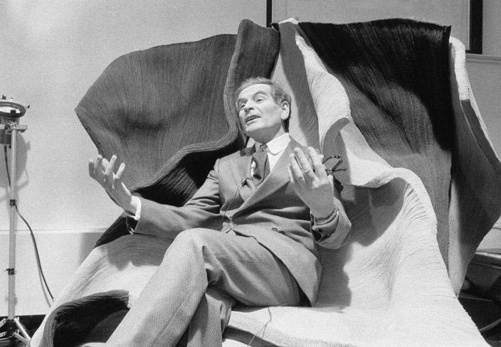 FILE - In this March 19, 1979 file photo, Pierre Cardin, famed French designer, holds a press conference on his return to the Peoples Republic of China. France's Academy of Fine Arts says famed fashion designer Pierre Cardin has died at 98. (AP Photo/Marty Lederhandler, File)