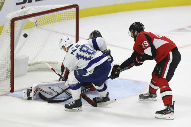 Tampa Bay Lightning left wing Ondrej Palat (18) scores on Ottawa Senators goaltender Craig Anderson (41) as right wing Scott Sabourin (49) attempts to defend during second period of NHL hockey action in Ottawa, Saturday, Oct. 12, 2019. (Fred Chartrand/The Canadian Press via AP)