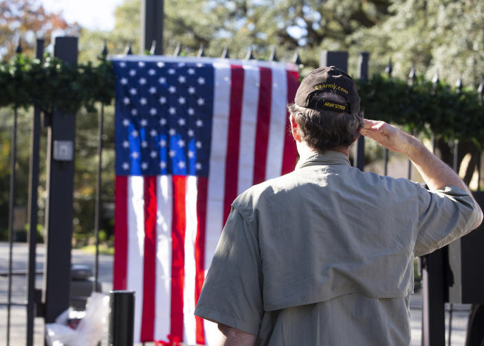 Streven Grimes, who served in the Gulf War 1990-91 and in the military from 1975 to 2007, salutes in tribute to former President George H. W. Bush, at the makeshift memorial formed outside the Bush home in Houston on Dec. 1. (Photo: Thomas B. Shea/AFP/Getty Images)