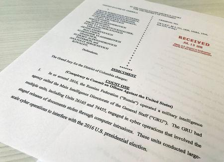 A copy of the grand jury indictment against 12 Russian intelligence officers is seen after the indictments were filed in U.S. District Court by prosecutors working as part of special counsel Robert Mueller's Russia investigationÊin Washington, U.S., July 13, 2018. REUTERS/Jim Bourg