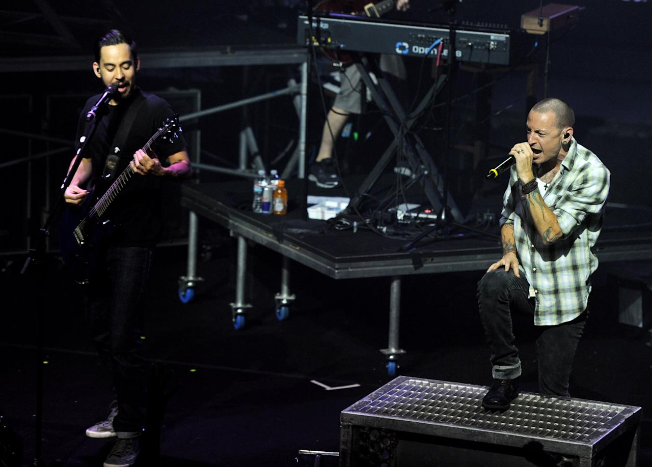 LOS ANGELES, CA - AUGUST 31:  Musicians Mike Shinoda (L) and Chester Bennington of Linkin Park perform for fans that raised money to benefit Music For Relief and Save The Children of Japan at the Mayan Theatre on August 31, 2011 in Los Angeles, California.  (Photo by Kevin Winter/Getty Images)