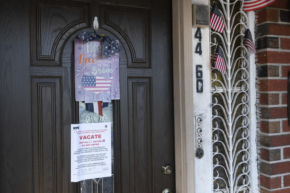 A vacate order from the New York City Department of Buildings is posted on an apartment building door, Friday, Sept. 3, 2021 in the Queens borough of New York. People died in a basement apartment Wednesday as rain and flooding from the remnants of Hurricane Ida sent the New York City area into a state of emergency. (AP Photo/Mark Lennihan)