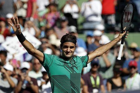 Mar 27, 2017; Miami, FL, USA; Roger Federer of Switzerland celebrates after winning match point against Juan Martin del Potro of Argentina (not pictured) on day seven of the 2017 Miami Open at Crandon Park Tennis Center. Federer won 6-3, 6-4. Mandatory Credit: Geoff Burke-USA TODAY Sports