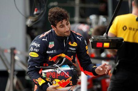 Formula One - F1 - Australian Grand Prix - Melbourne, Australia - 25/03/2017 Red Bull Racing driver Daniel Ricciardo of Australia reacts as he walks down pit lane after crashing out of the qualifying session. REUTERS/Brandon Malone
