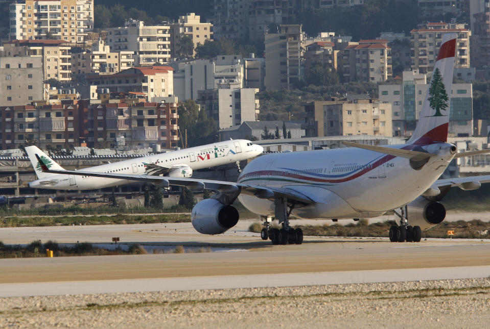 FILE - In this Jan. 27, 2010 file photo, a Middle East Airlines jet takes off at the Rafik Hariri International Airport in Beirut, Lebanon. On Wednesday, July 1, 2020, Beirut's airport is partially reopening after a three-month shutdown. Lebanon's cash-strapped government hopes thousands of Lebanese expatriates will return for the summer, injecting badly needed dollars into the sinking economy. (AP Photo/Hussein Malla, File)