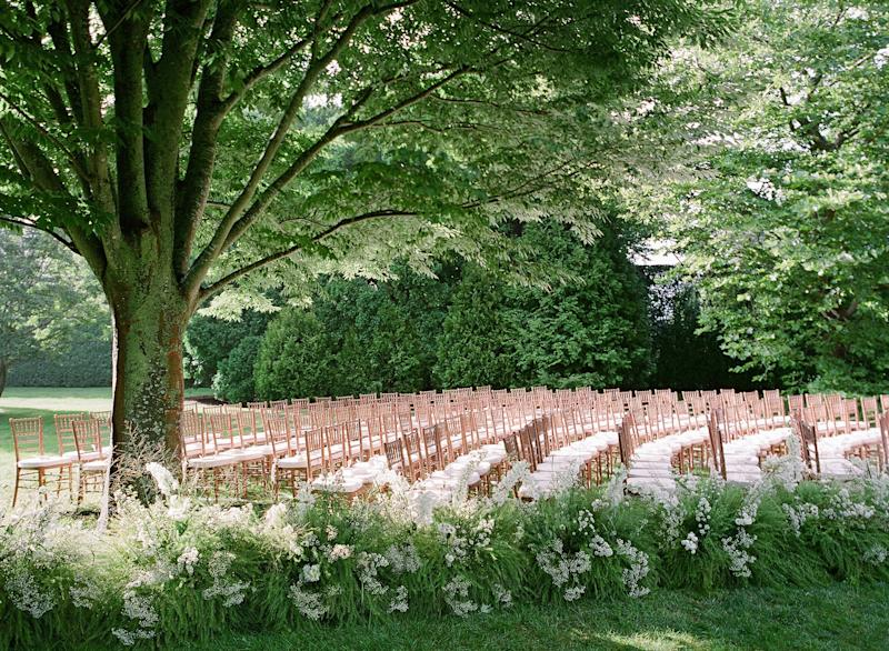 The incredible Putnam & Putnam team lined the aisle of zelkova trees with wild grasses, delphinium, baby's breath, and lisianthus.