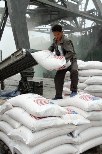 A North Korean worker unloads bags of US wheat in the western port of Nampo in 2008. North Korea's new leadership has agreed to suspend nuclear tests and its uranium enrichment programme as part of a deal that includes US food aid for the impoverished nation