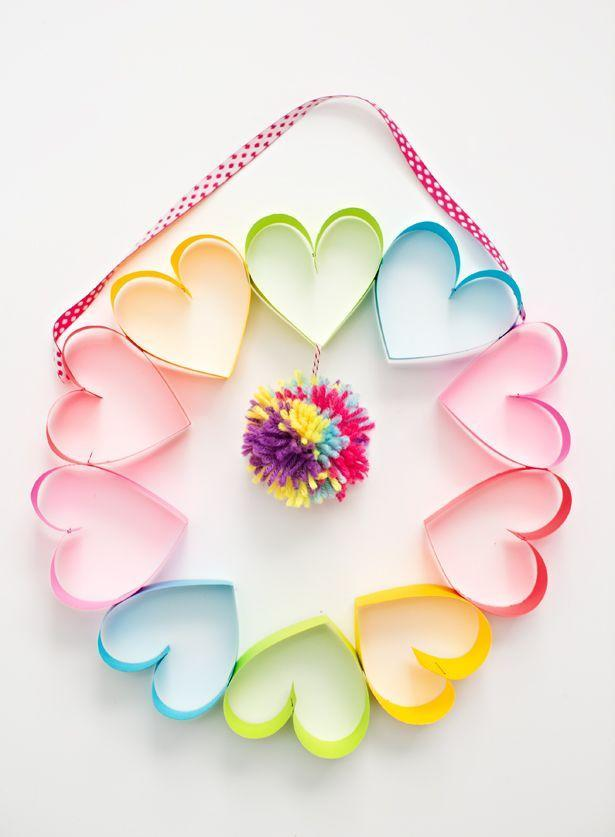 """<p>Show your fun-loving mom how much you love her with a colorful, heart-shaped wreath fitted with a festive pom-pom.</p><p><strong>Get the tutorial at <a href=""""https://www.hellowonderful.co/post/DIY-RAINBOW-PAPER-HEART-POM-POM-WREATH/"""" rel=""""nofollow noopener"""" target=""""_blank"""" data-ylk=""""slk:Hello, Wonderful"""" class=""""link rapid-noclick-resp"""">Hello, Wonderful</a>.</strong></p><p><strong>What you'll need: </strong><em>woven ribbon ($17, <a href=""""http://www.michaels.com/ribbon-value-pack-by-celebrate-it/10534764.html"""" rel=""""nofollow noopener"""" target=""""_blank"""" data-ylk=""""slk:michaels.com"""" class=""""link rapid-noclick-resp"""">michaels.com</a>)</em>; <em>multi-colored cardstock ($13, <a href=""""https://www.papersource.com/item/Cardstock-Ultra-Bright-Springtime-Packet-8.5-x-11/2506_221/38000025.html"""" rel=""""nofollow noopener"""" target=""""_blank"""" data-ylk=""""slk:papersource.com"""" class=""""link rapid-noclick-resp"""">papersource.com</a>)</em></p>"""