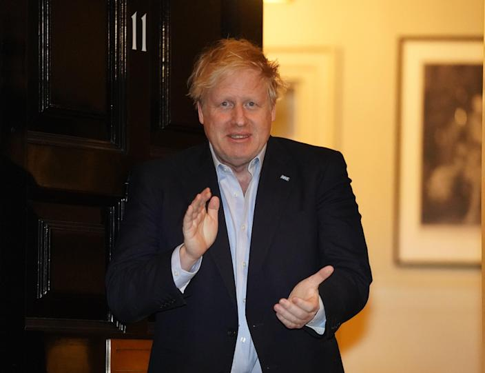 LONDON, April 2, 2020 .File photo taken on April 2, 2020 shows British Prime Minister Boris Johnson clapping for National Health Service staff outside 11 Downing Street in London, Britain. British Prime Minister Boris Johnson was taken to intensive care on Monday night after his coronavirus symptoms worsened, Downing Street said. Johnson has asked Foreign Secretary Dominic Raab to deputize for him, a Downing Street spokesman said. (Pippa Fowles/No 10 Downing Street/Handout to Xinhua via Getty) (EDITORIAL USE ONLY) (Xinhua/Han Yan via Getty Images)