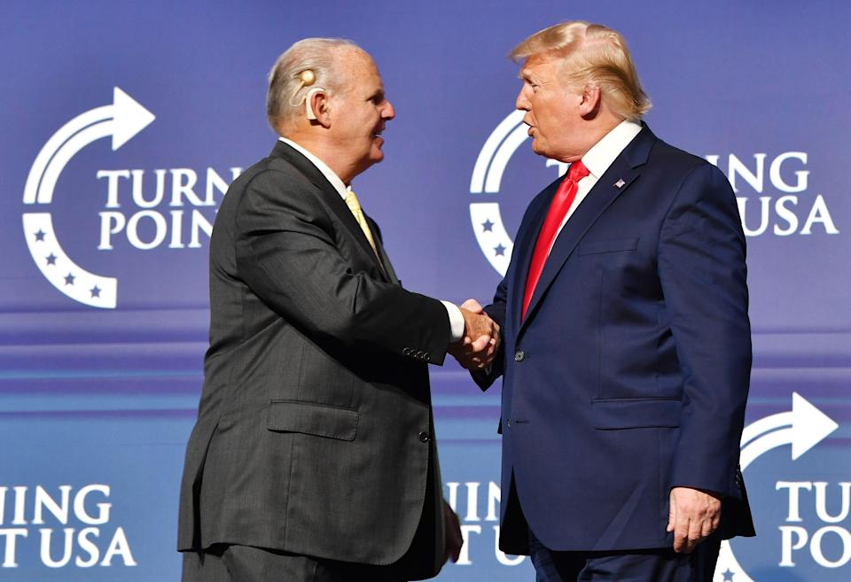 Friends and mutual admirers Rush Limbaugh and President Donald Trump greet each other during the Turning Point USA Student Action Summit at the Palm Beach County Convention Center in West Palm Beach, Fla., on Dec. 21, 2019.