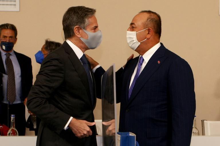 US Secretary of State Antony Blinken (l) greets Turkish Foreign minister Mevlut Cavusoglu ahead of the G20 meeting in Italy