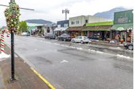 """<p><strong>The Setting: </strong><a href=""""http://www.exploresquamish.com/"""" rel=""""nofollow noopener"""" target=""""_blank"""" data-ylk=""""slk:Squamish, British Columbia, Canada"""" class=""""link rapid-noclick-resp"""">Squamish, British Columbia, Canada </a></p><p><span class=""""redactor-invisible-space"""">When the leading lady in this cute holiday flick attempts to shut down a cookie factory in a small town, she inadvertently falls in love with the factory owner—and the town itself. It's easy to see why. Some of the scenes are set in the sweet little Canadian town of Squamish. Nestled in the mountains near Shannon Falls<span class=""""redactor-invisible-space"""">, the stunning city is an </span>ideal place to shoot a Hallmark movie; the Christmas-themed installment of the <em>Murder, She Baked</em> murder-mystery series<em>, </em></span>called <em>A Plum Pudding Mystery</em><span class=""""redactor-invisible-space"""">, <span class=""""redactor-invisible-space"""">was also shot in <a href=""""http://www.squamishchief.com/news/local-news/murder-mystery-film-hits-squamish-1.2098052"""" rel=""""nofollow noopener"""" target=""""_blank"""" data-ylk=""""slk:downtown Squamish"""" class=""""link rapid-noclick-resp"""">downtown Squamish</a>.</span></span></p>"""