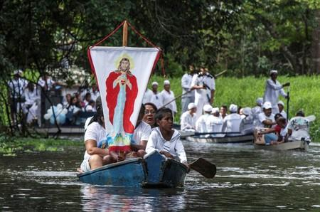 FILE PHOTO: Roman Catholic pilgrims travel as they accompany the statue of Our Lady of Conception during an annual river procession and pilgrimage along the Caraparu River in Santa Izabel do Para