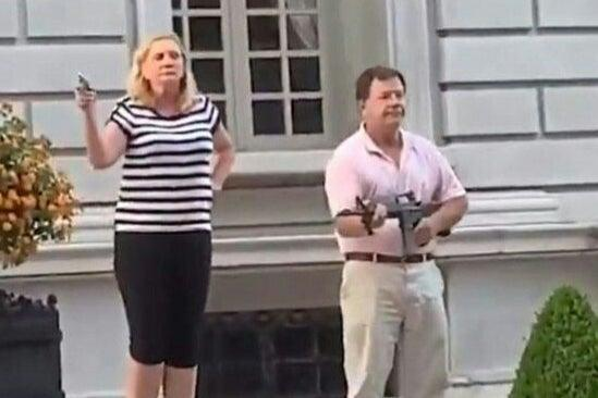 Mark McCloskey and wife Patricia were filmed standing outside their home holding guns at Black Lives Matter protesters (Daniel Shular via Eurovision/AFP)