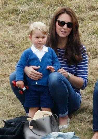 """<p>Kate and her son, Prince George, both attend a charity polo match in Tetbury in 2015. Kate is working her cool mum on the go look, complete with <a href=""""https://www.johnlewis.com/ray-ban-rb2140-unisex-new-wayfarer-sunglasses/p573106?sku=237826877&colour=Black%2FGreen&s_ppc=2dx92700056180405819&tmad=c&tmcampid=2&gclid=Cj0KCQiA34OBBhCcARIsAG32uvNl1mdWNem9BQqhaXQja7sWSqj7ijrZjCrYwPGU5Z4lHYZ0RvldFUoaAocKEALw_wcB&gclsrc=aw.ds"""" rel=""""nofollow noopener"""" target=""""_blank"""" data-ylk=""""slk:Ray-Ban Wayfarers"""" class=""""link rapid-noclick-resp"""">Ray-Ban Wayfarers</a>, a striped <a href=""""https://www.boden.co.uk/en-gb/womens-tops-t-shirts/breton-tops"""" rel=""""nofollow noopener"""" target=""""_blank"""" data-ylk=""""slk:Breton top"""" class=""""link rapid-noclick-resp"""">Breton top</a>, and skinny jeans. </p>"""