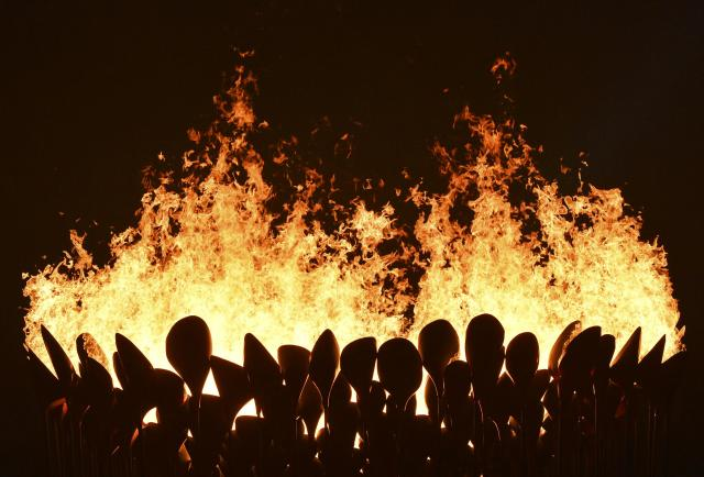 Flames leap from the cauldron during the opening ceremony of the London 2012 Olympic Games at the Olympic Stadium July 27, 2012. REUTERS/Toby Melville (BRITAIN - Tags: SPORT OLYMPICS TPX IMAGES OF THE DAY)