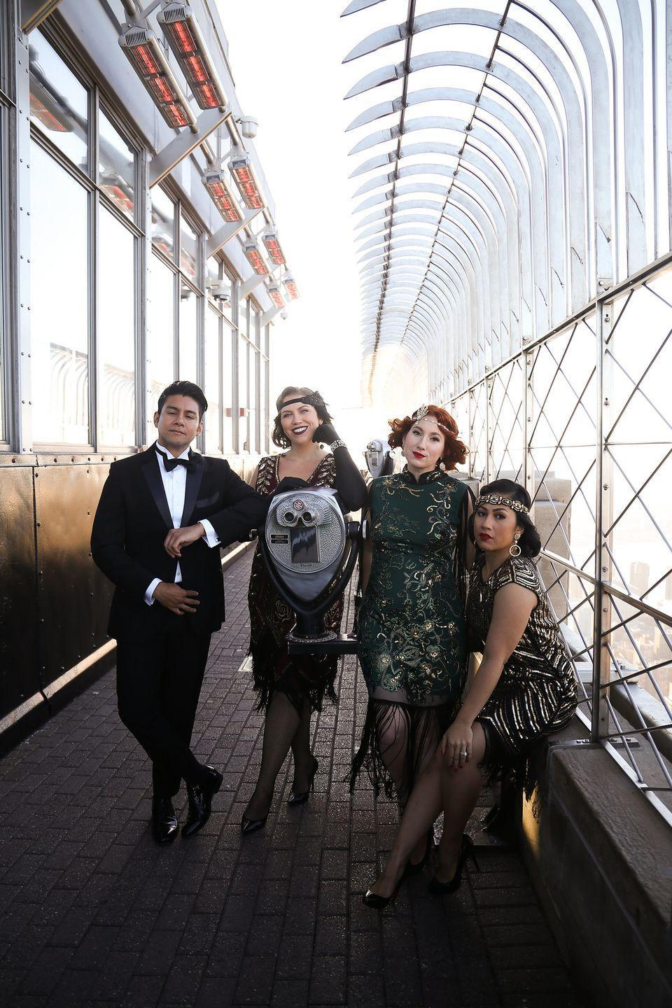 """<p>Not feeling crafty? Channel your inner flapper with these beautiful 1920s-inspired dresses you can purchase for a quick group idea (they're honestly pretty enough to wear to an event another time!).</p><p><strong>Get the tutorial at </strong><strong><a href=""""http://livingaftermidnite.com/2019/10/group-halloween-costumes-that-will-win-you-best-dressed.html"""" rel=""""nofollow noopener"""" target=""""_blank"""" data-ylk=""""slk:Living after Midnite"""" class=""""link rapid-noclick-resp"""">Living after Midnite</a>.</strong></p><p><a class=""""link rapid-noclick-resp"""" href=""""https://www.amazon.com/Metme-Roaring-Dresses-Cocktail-Flapper/dp/B07M6P42R7/ref=sr_1_2?dchild=1&keywords=roaring+20s+dress+women&qid=1591987370&sr=8-2&tag=syn-yahoo-20&ascsubtag=%5Bartid%7C10050.g.21349110%5Bsrc%7Cyahoo-us"""" rel=""""nofollow noopener"""" target=""""_blank"""" data-ylk=""""slk:SHOP FLAPPER'S DRESSES"""">SHOP FLAPPER'S DRESSES</a></p>"""