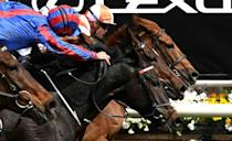 """Craig Williams (right) drives Vow and Declare to win last year's Melbourne Cup in a thrilling finish from Prince of Arran. This year """"the race that stops a nation"""" will be held without spectators for the first time in its 144-year history"""