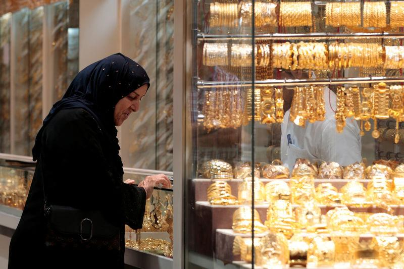 A woman shops for jewellery at a shop in the Gold Souq in Dubai