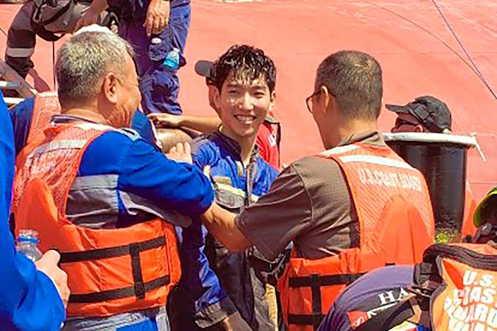 In this image released by the U.S. Coast Guard shows a crew member of the cargo ship Golden Ray as he is helped off the capsized ship Monday, Sept. 9, 2019 off St. Simons Island, Ga.