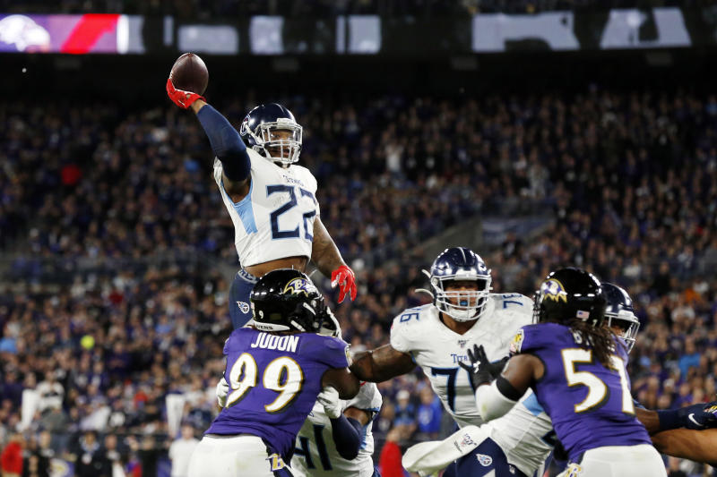 Derrick Henry throws a touchdown pass to Corey Davis in the Tennessee Titans' divisional round victory over the Baltimore Ravens. Henry's high school coach told Yahoo Sports he ran a nearly identical play almost a decade ago. (Todd Olszewski/Getty Images)