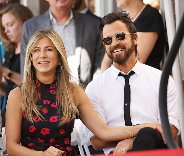 """<p>How happy do Jen and Justin look while supporting her friend (and frequent co-star) Jason Bateman at his Hollywood Walk of Fame induction ceremony? When it was her turn at the podium, Aniston referred to Bateman as her <a href=""""https://www.yahoo.com/celebrity/jennifer-aniston-brings-laughs-while-203300809.html"""" data-ylk=""""slk:""""partner in crime."""""""" class=""""link rapid-noclick-resp"""">""""partner in crime.""""</a> (Photo: Michael Tran/FilmMagic) </p>"""
