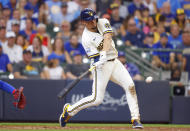 Milwaukee Brewers shortstop Willy Adames hits a grand-slam against the Chicago Cubs during the fourth inning of a baseball game Wednesday, June 30, 2021, in Milwaukee. (AP Photo/Jeffrey Phelps)