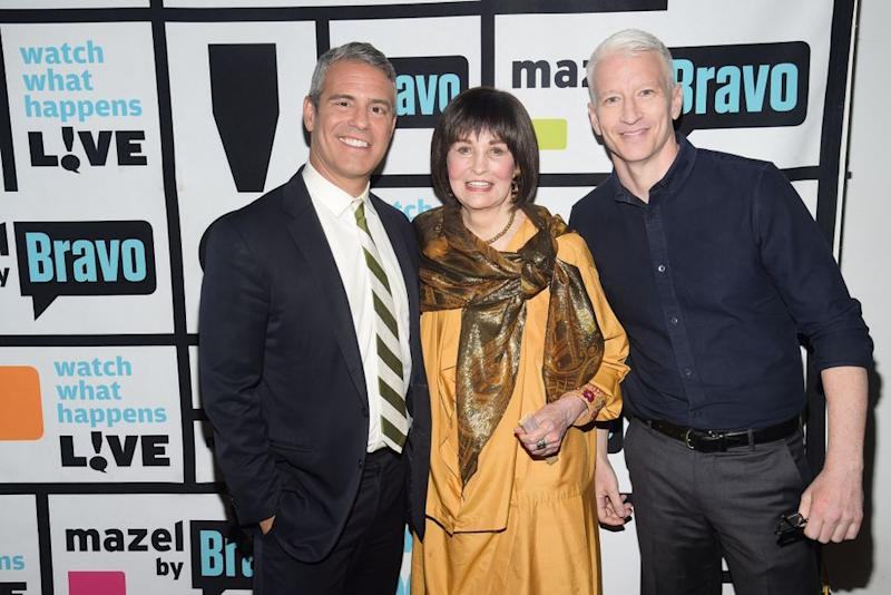 Andy Cohen (left) and Anderson Cooper with his mom Gloria Vanderbilt. | Charles Sykes/Bravo via Getty
