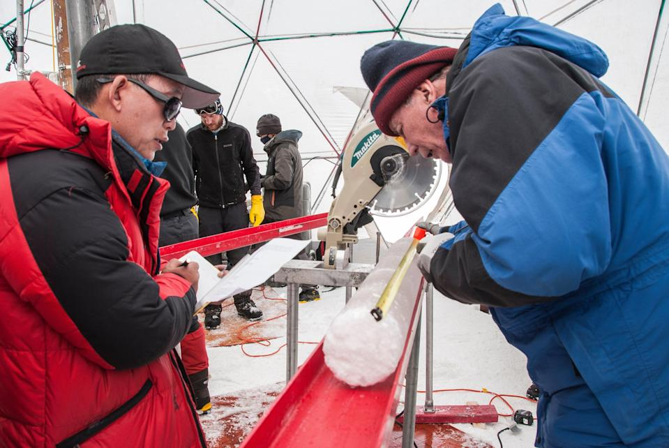 Yao Tandong, left, and Lonnie Thompson process an ice core drilled from the Tibetan Plateau in 2015 (Lonnie Thompson, The Ohio State University)