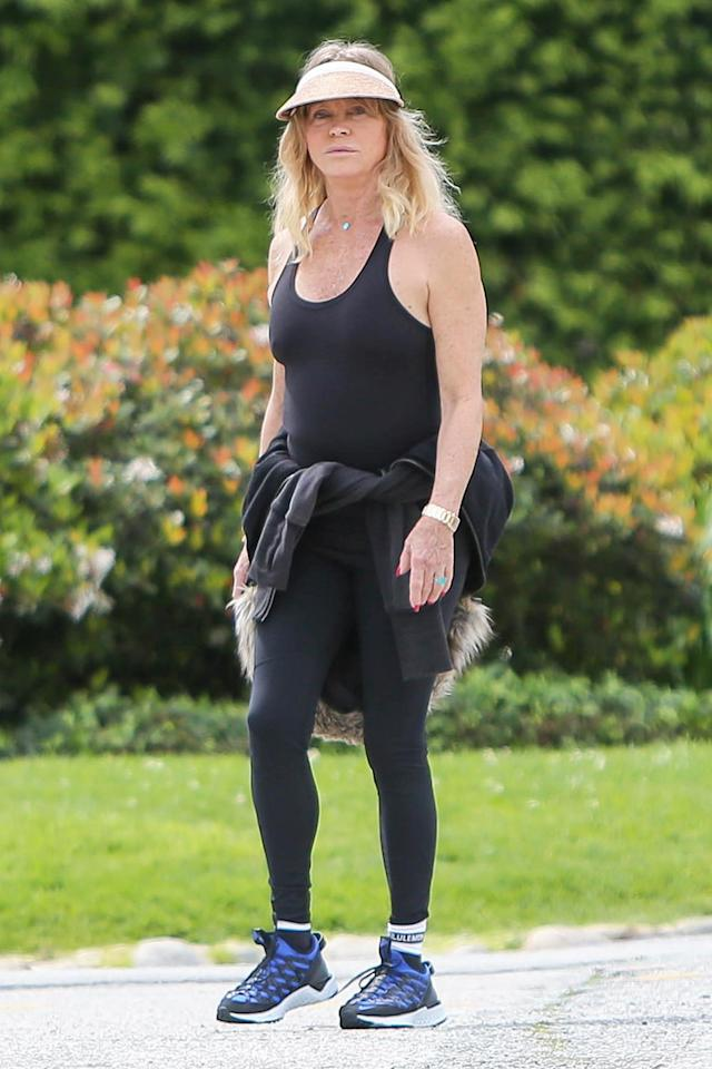 <p>Goldie Hawn gets her steps in during L.A.'s shelter-in-place mandate on Wednesday.</p>