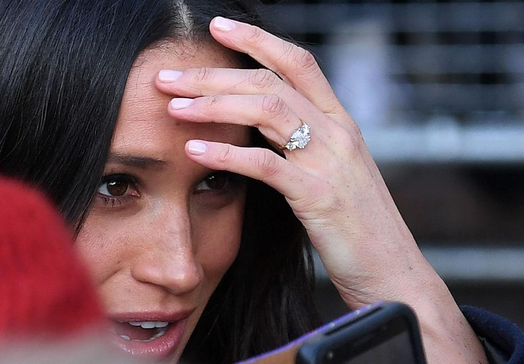 <p>While the three-diamond ring Harry gave Meghan is estimated at £50,000 ($87,903 CAD). <em>(Photo: Getty)</em> <strong>Click through the gallery for more of the world's most iconic royal engagement rings! </strong> </p>