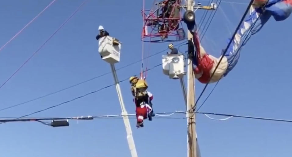 Fire crews rescue a man dressed as Santa from power lines in Sacramento, California.