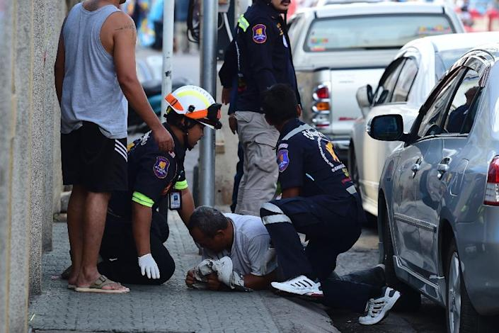 Rescue workers attend to an injured man after a small bomb exploded in Thailand's Hua Hin on August 12 (AFP Photo/Munir Uz Zaman)