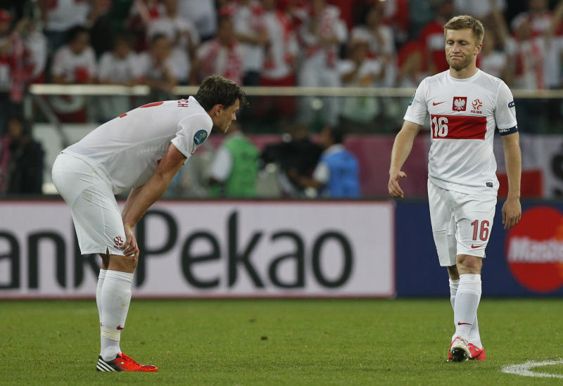 Poland's Sebastian Boenisch, left, and Jakub Blaszczykowski leave the pitch after losing the Euro 2012 soccer championship Group A match between Czech Republic and Poland in Wroclaw, Poland, Saturday, June 16, 2012. (AP Photo/Czarek Sokolowski)