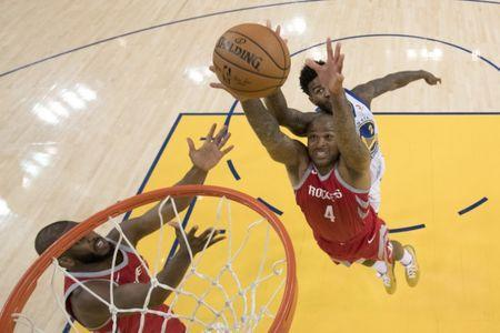 May 20, 2018; Oakland, CA, USA; Houston Rockets forward P.J. Tucker (4) grabs a rebound against Golden State Warriors center Jordan Bell (2) during the second half in game three of the Western conference finals of the 2018 NBA Playoffs at Oracle Arena. The Warriors defeated the Rockets 126-85. Mandatory Credit: Kyle Terada-USA TODAY Sports
