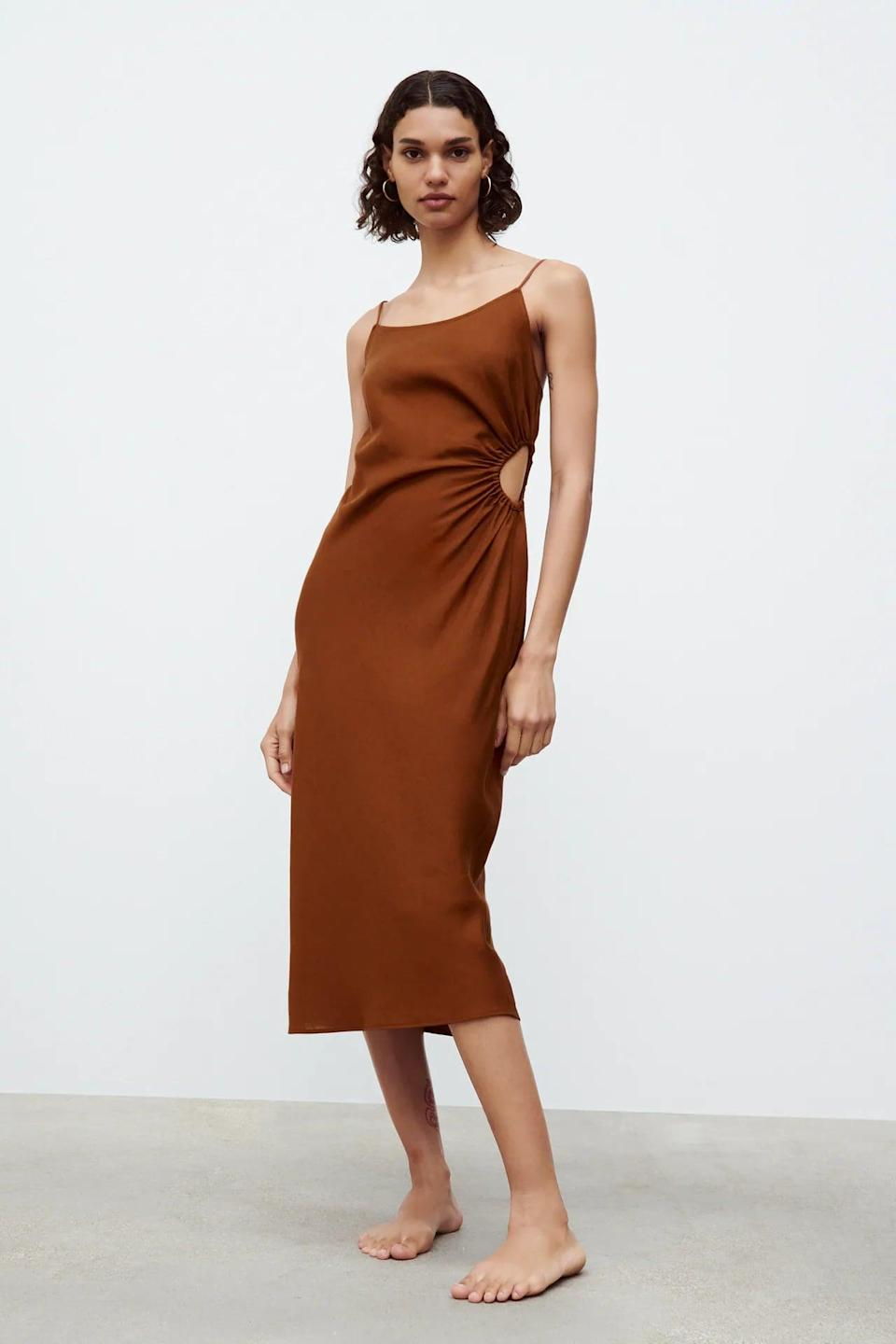 <p>The side detail of this <span>Cut Out Linen Blend Dress</span> ($50) is so well-placed, it makes it sexy in the best possible way. We also love the rust color; create a nice contrast by pairing it with blue strappy heels.</p>