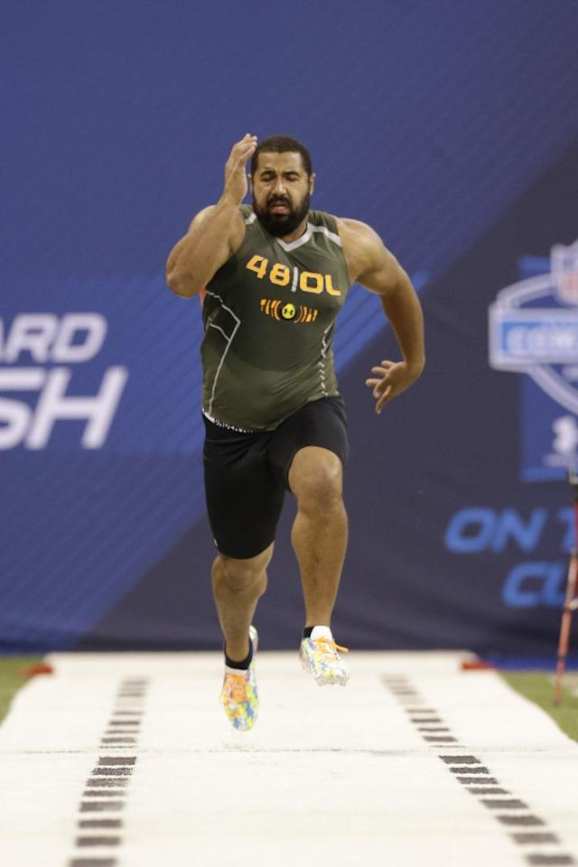 FILE - In this Feb. 22, 2014 file photo, Penn State offensive lineman John Urschel runs the 40-yard dash at the NFL football scouting combine in Indianapolis. The most exciting thing about finishing the combine is that I am no longer training like a track athlete. I am once again a football player, and now am focused on doing all I can to ensure that I am prepared for my pro day. (AP Photo/Nam Y. Huh, File)